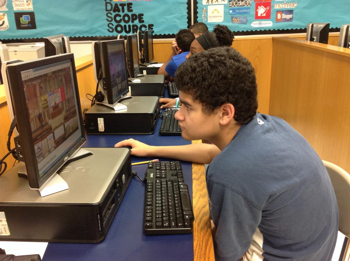 Student engaged with iCivics games
